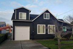 Reroofing in Renton, WA on a home with dark siding
