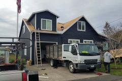 Roofers reroofing a home in Renton, WA