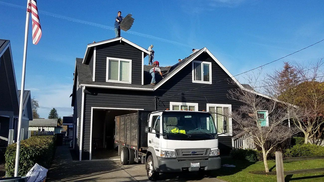 Roofer's Installing a Composition Roof in Renton, WA